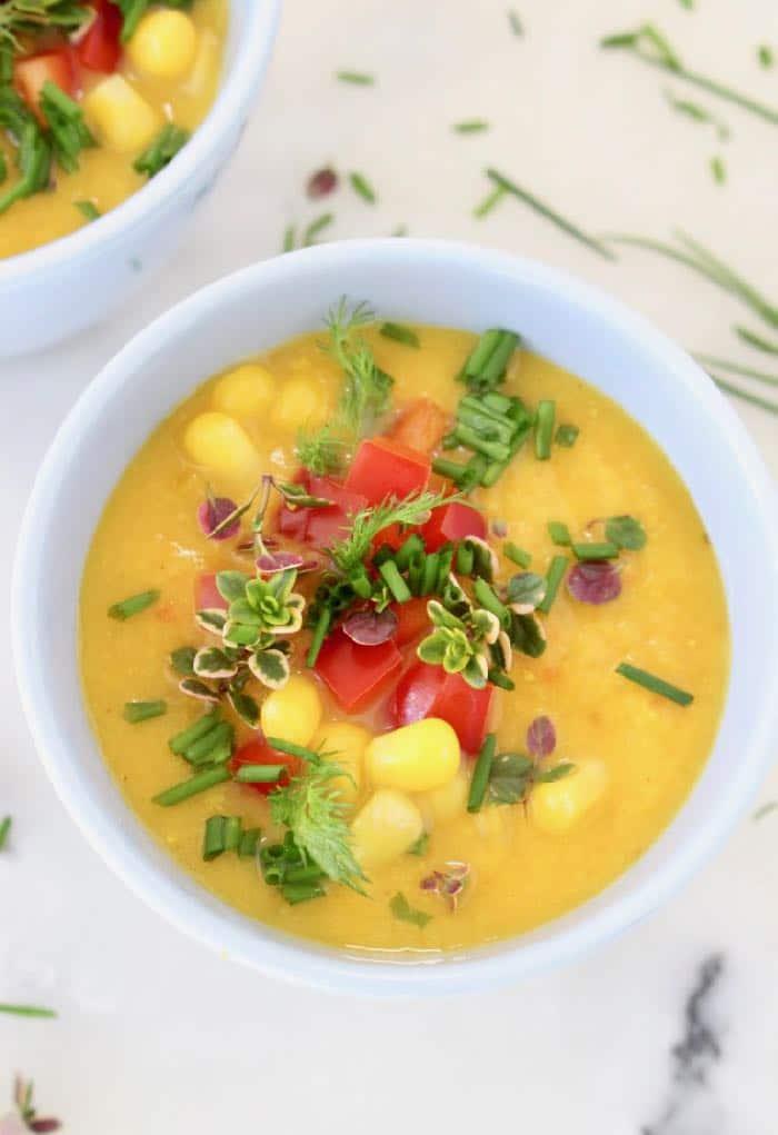 Vegan Potato Corn Chowder Bowls with fresh Herbs and Red Bell Pepper