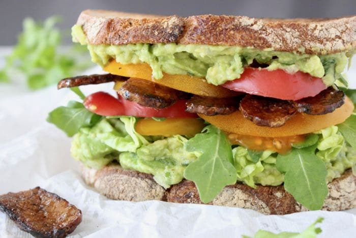 Vegan Avocado Tempeh Sandwich with Lettuce and Tomatoes