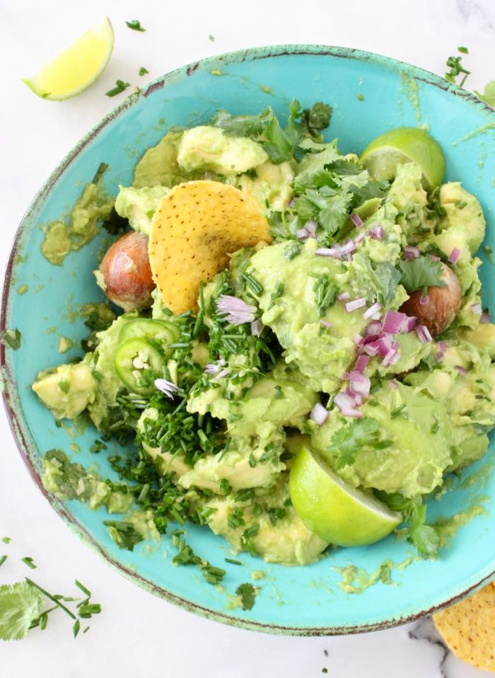 the Best Chunky Guacamole Recipe with Serrano Peppers, Cilantro and Lime.
