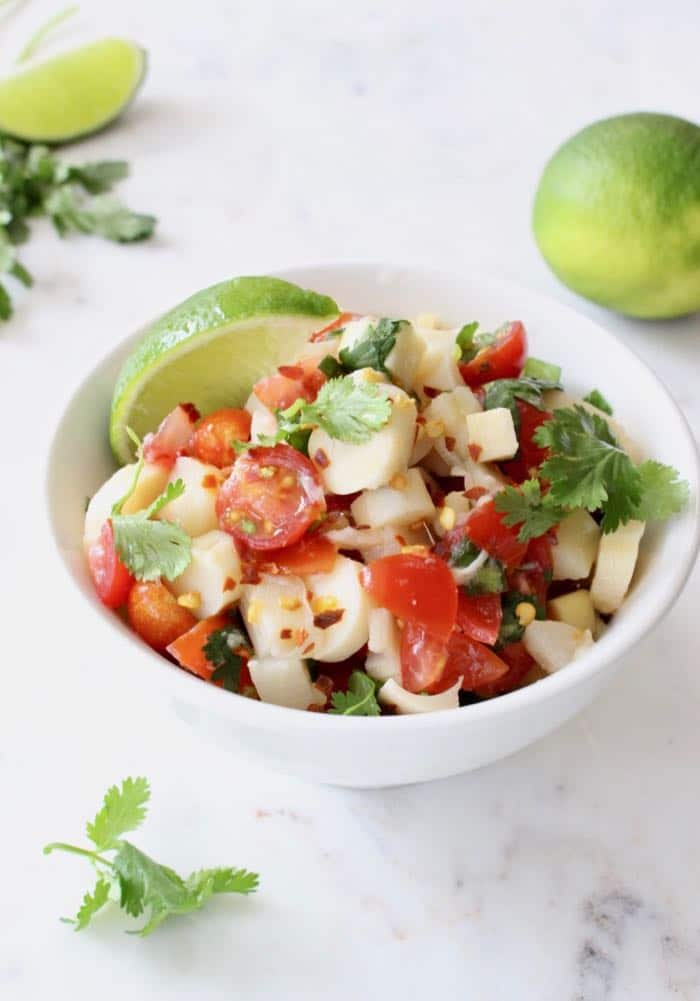 Vegan Hearts of Palm Ceviche Recipe with Tomatoes, Scallions, Cilantro and Lime.
