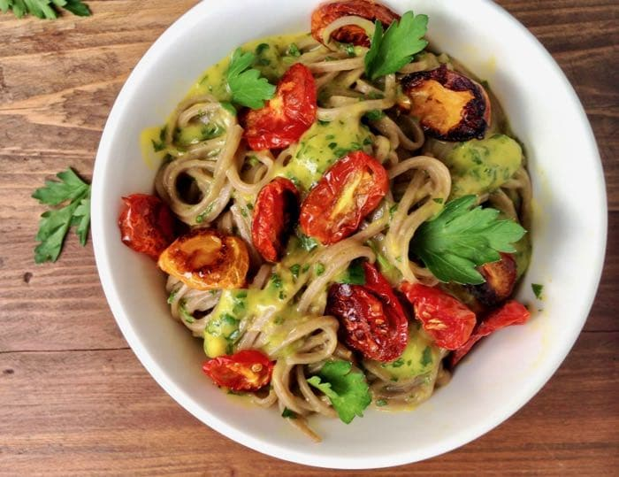 Sweet and savory mango basil sauce with garlic and lime over soba noodles.