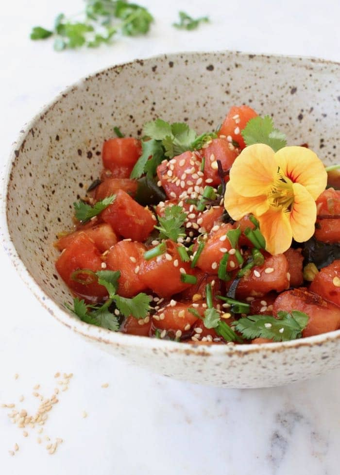 Vegan Watermelon Poke Bowl with Dressing and Sea Vegetables.