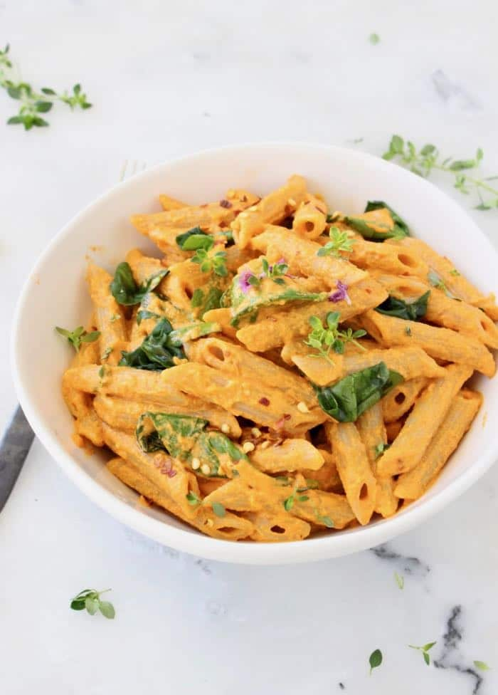Creamy Vegan Roasted Red Pepper Pasta Sauce with Spinach and Cashews.