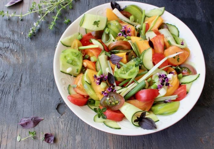 Cucumber Tomato Onion Salad Recipe with Vinegar Dressing Fresh Basil.