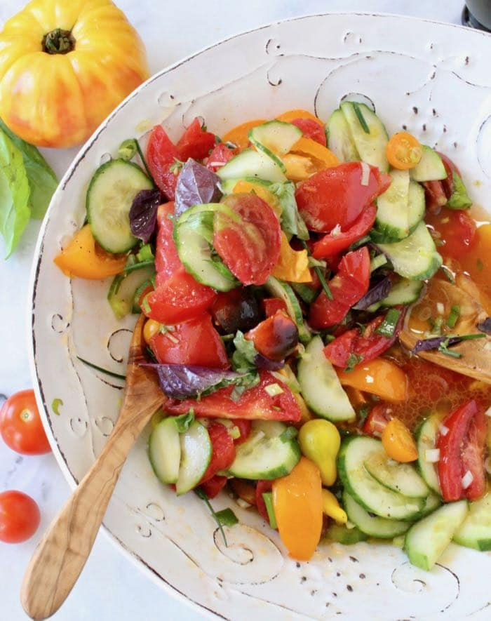 Heirloom Tomato Onion Cucumber Salad Recipe with Vinegar Dressing and Basil.