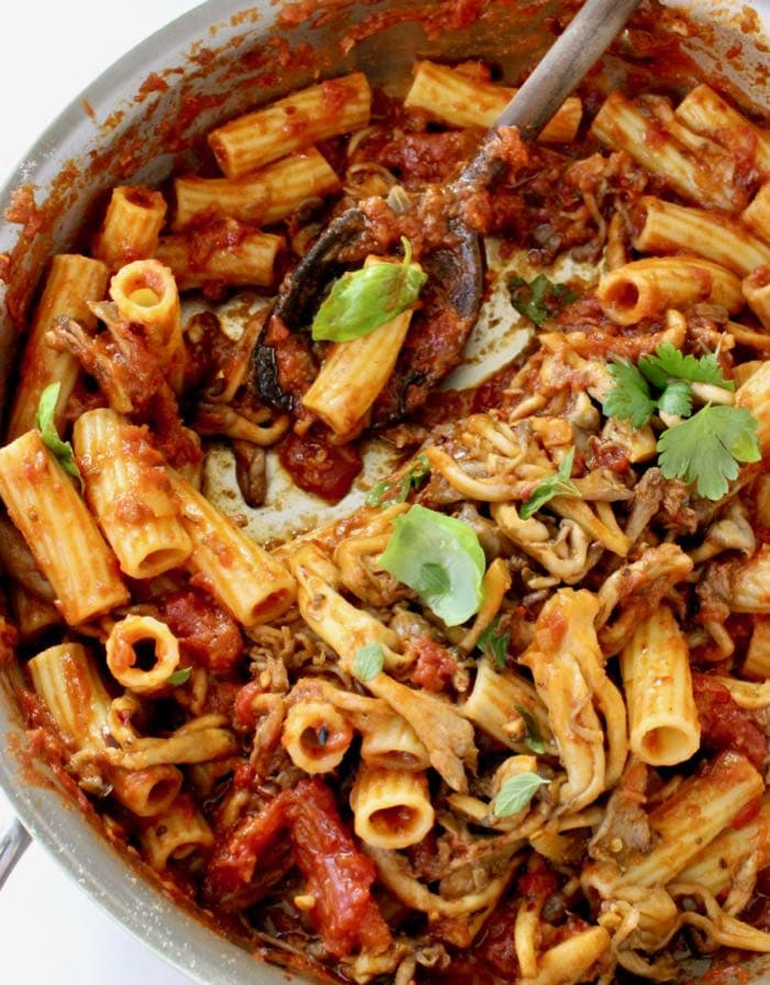 Easy roasted eggplant ragu with mushrooms, tomatoes and roasted peppers.