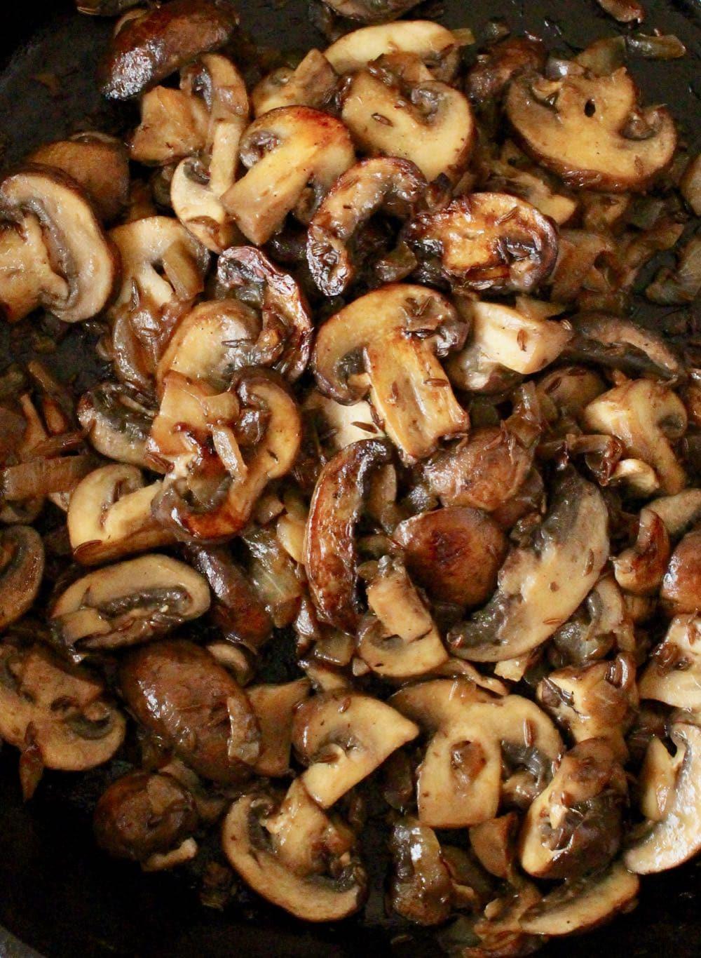 caramelized mushrooms in cast iron skillet