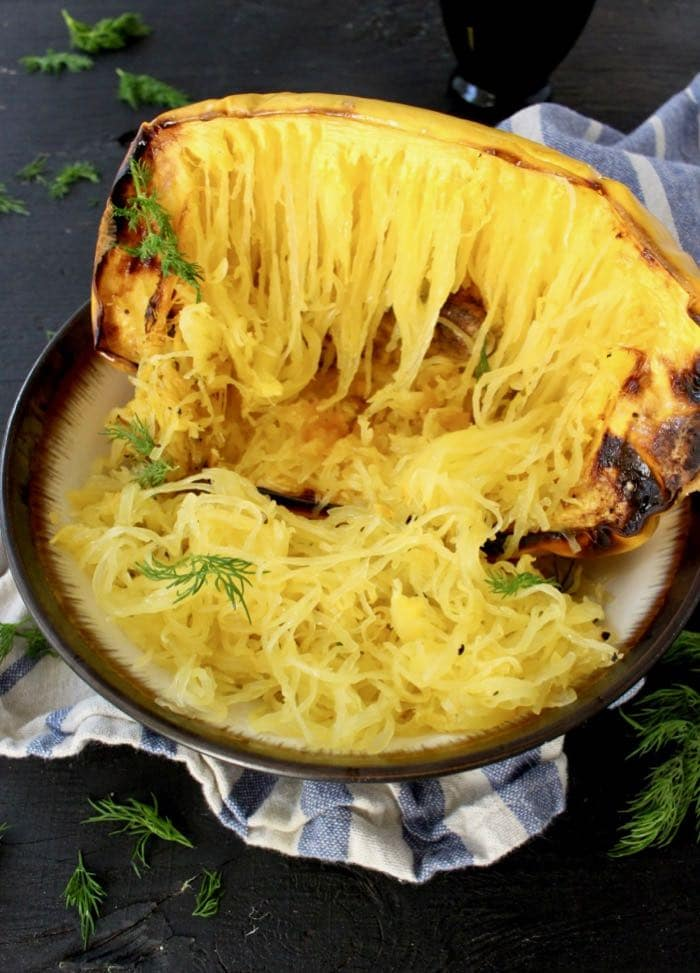 How to roast spaghetti squash halves in the oven with or without oil that comes out perfectly every time.