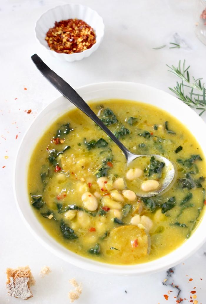 Tuscan White Bean Kale Soup recipe with winter squash, leeks, lacinato kale and creamy cannellini beans.