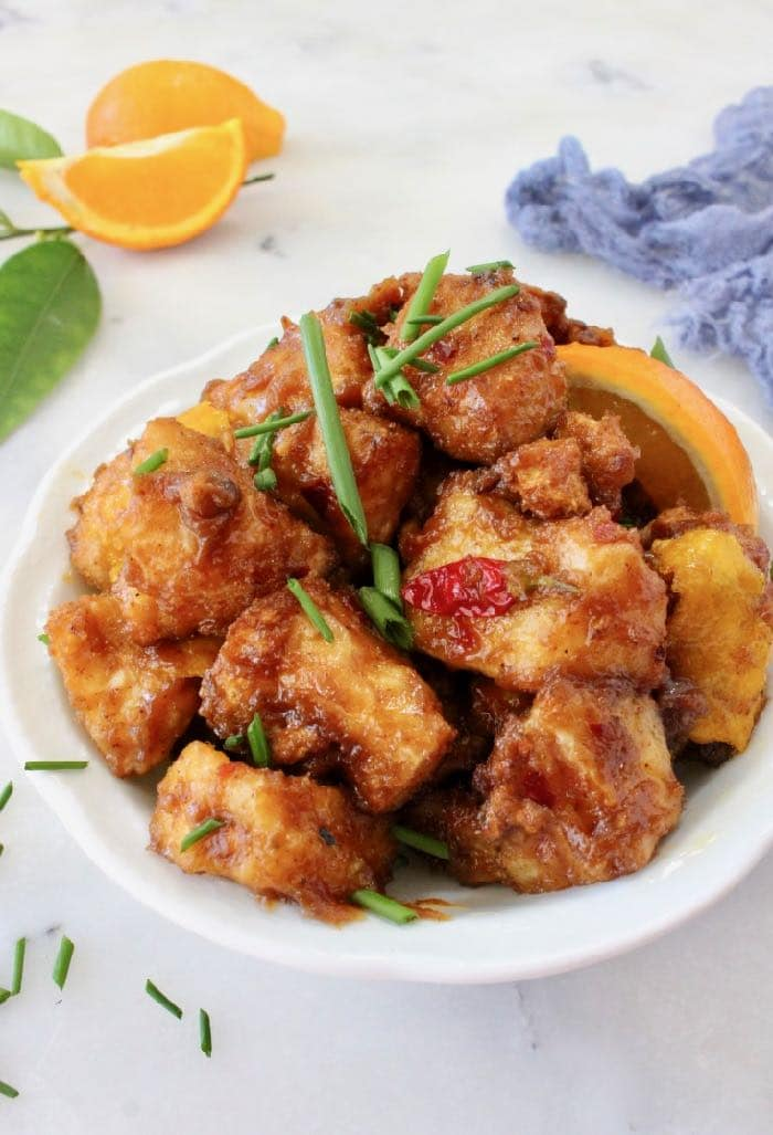 Orange tofu cooked in the air fryer without oil then tossed in a luscious orange glaze.