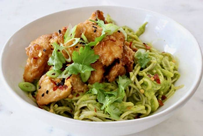 Air fried peanut tofu bowl with soba noodles in a raw mango avocado sauce