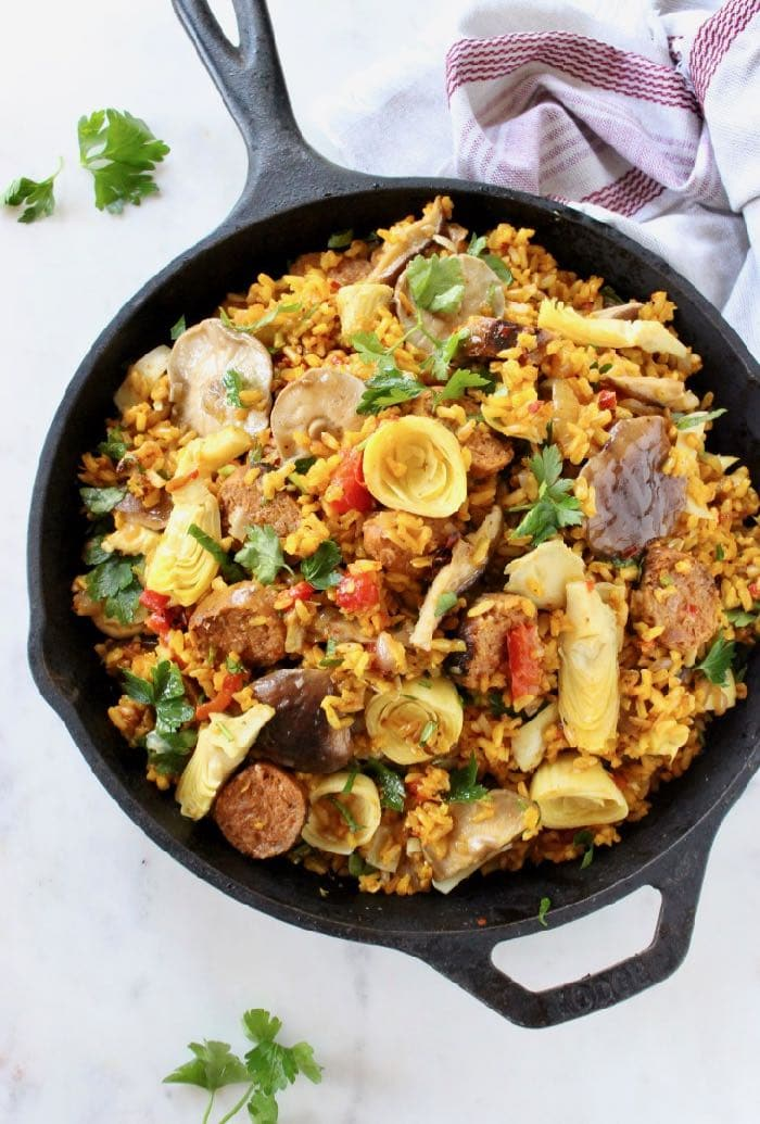 Best Vegan Paella with Brown Rice, Mushrooms and Artichokes.