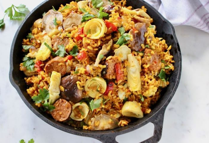 Vegan Paella Recipe with Brown Rice, Artichokes, Mushrooms and Saffron White Wine Broth.