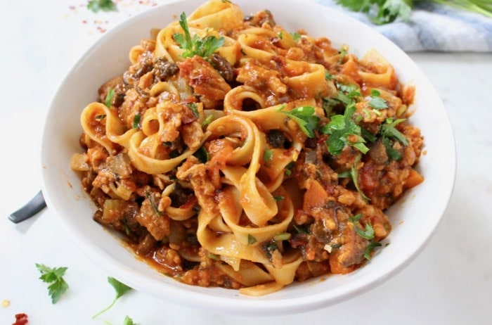 Easy vegan Bolognese sauce recipe made with meaty soy curls and TVP in a red wine San Marzano tomato sauce.