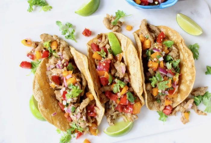 Vegan street tacos de carnitas with meaty soy curls and tomato salsa!