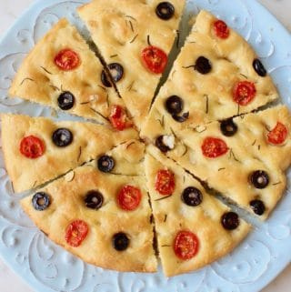 Vegan Rosemary Focaccia Bread with Cherry Tomatoes and Olives.