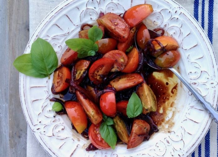 Italian balsamic tomato salad with red onion and basil.