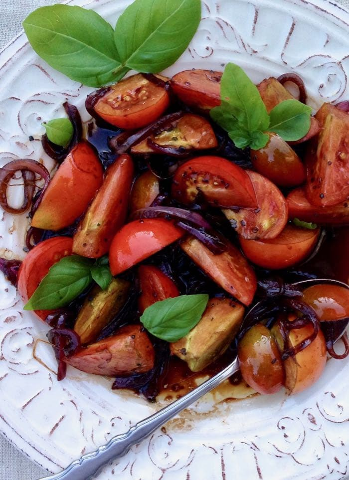 Classic Italian balsamic tomatoes with red onion and basil.