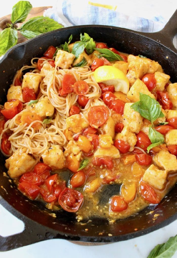 Best Italian Tofu in Garlic White Wine Sauce with cherry tomatoes and lemon.