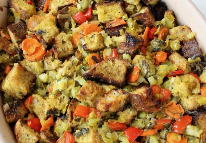 The best Classic Bread Stuffing recipe with caramelized leeks, veggies, crusty bread, sage and thyme