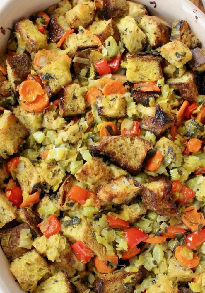 Traditional Classic Bread Stuffing recipe with caramelized leeks, veggies, crusty bread, sage and thyme