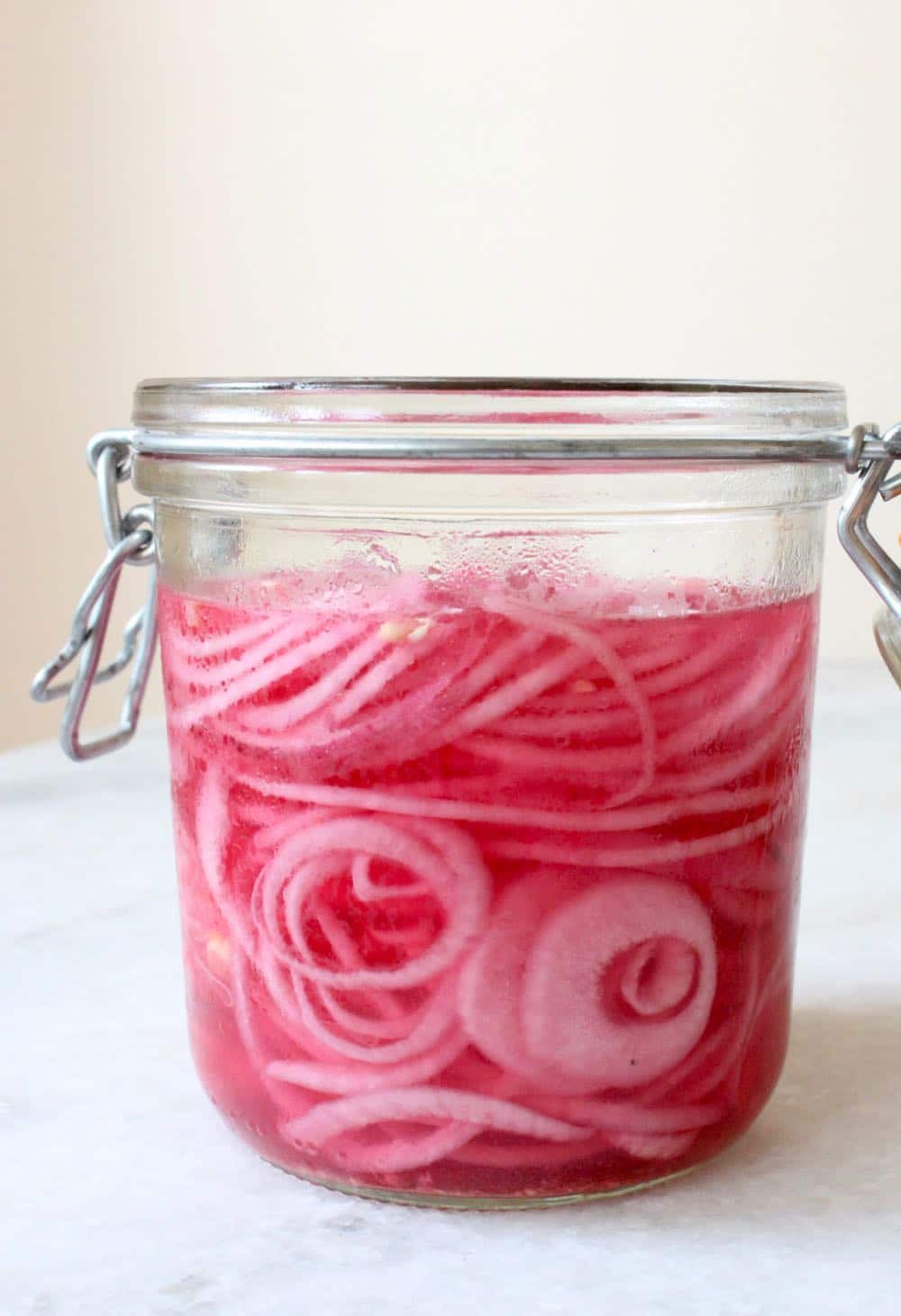 How to make quick and easy pickled red onions in a jar.