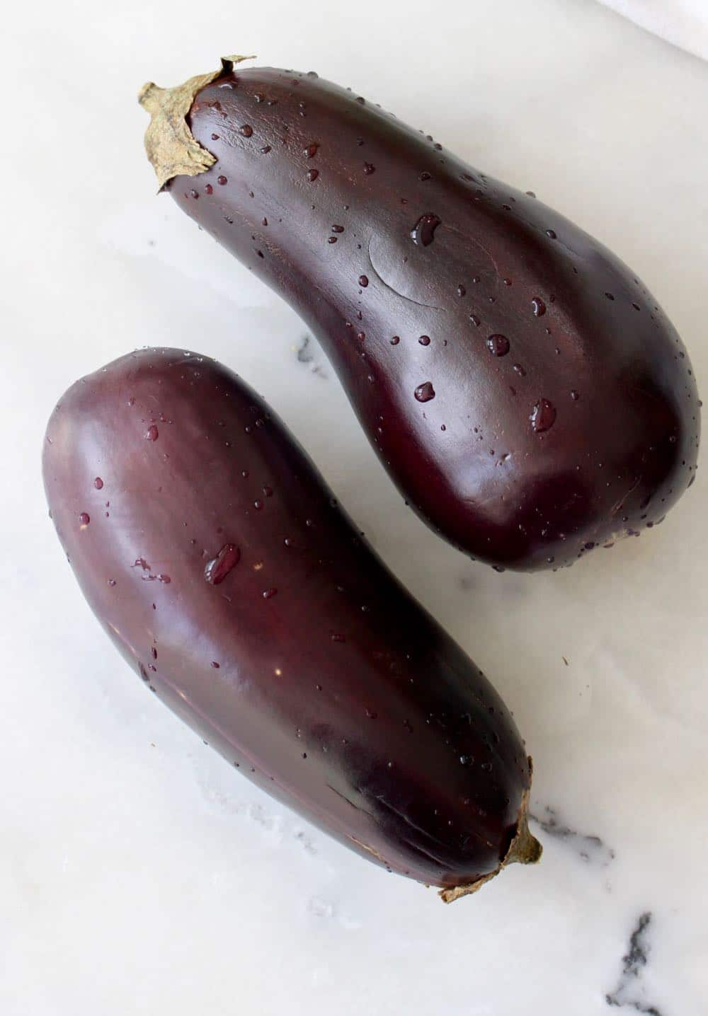 Italian Eggplants on marble table