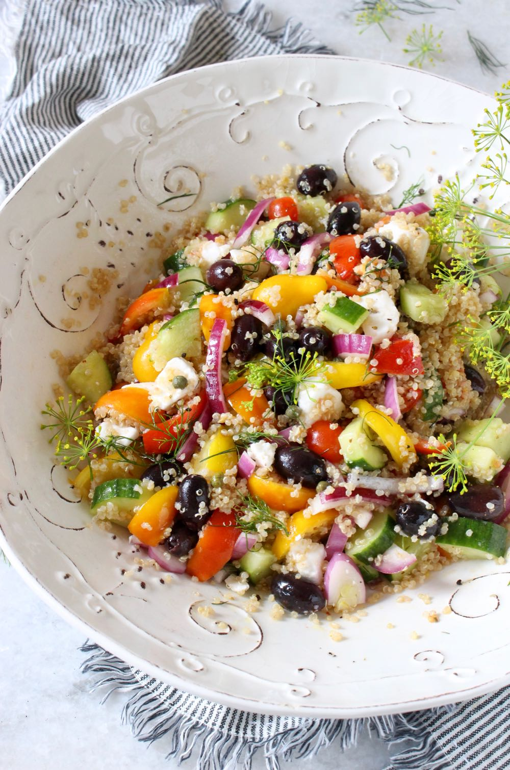 Classic Mediterranean quinoa salad with a zesty olive oil + red wine vinegar dressing.