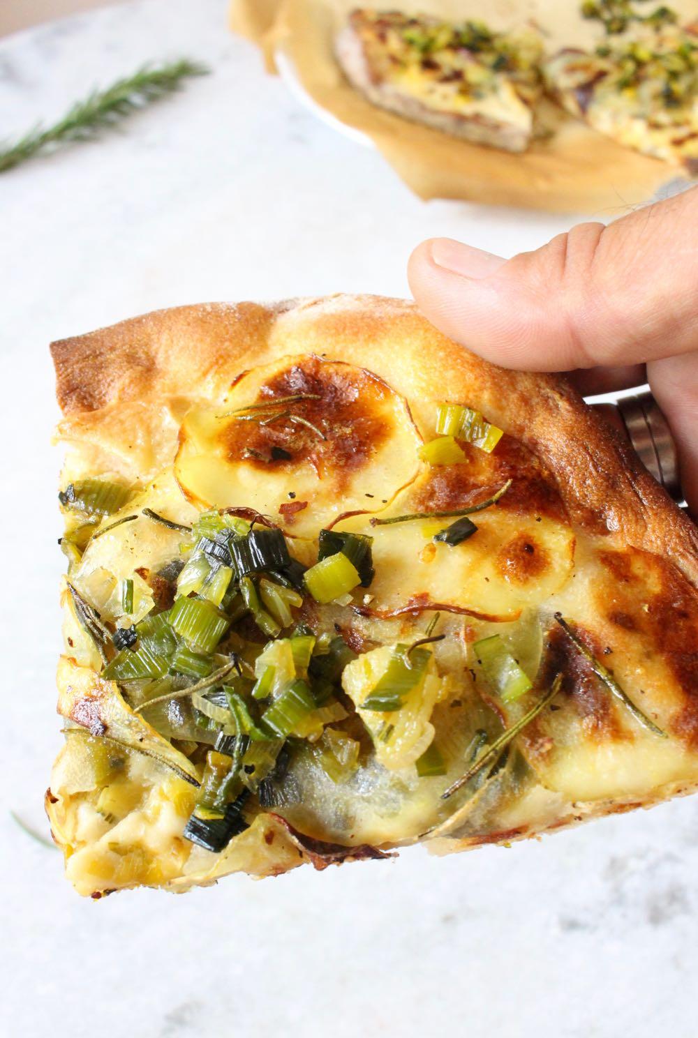 Thin crust slice of potato pizza