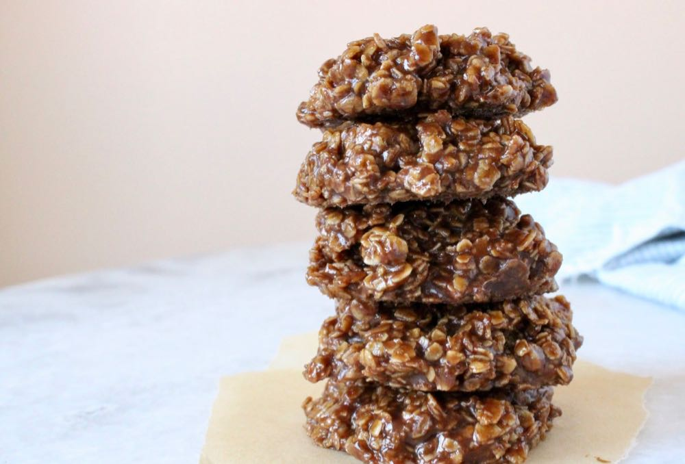 Stack of 5 vegan no bake peanut butter oatmeal cookies on marble