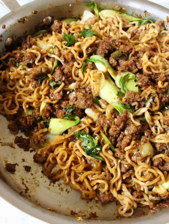 """best vegan ramen bowl recipe featuring """" beyond beef """" lots of garlic and ginger, bok choy and a quick umami sauce"""