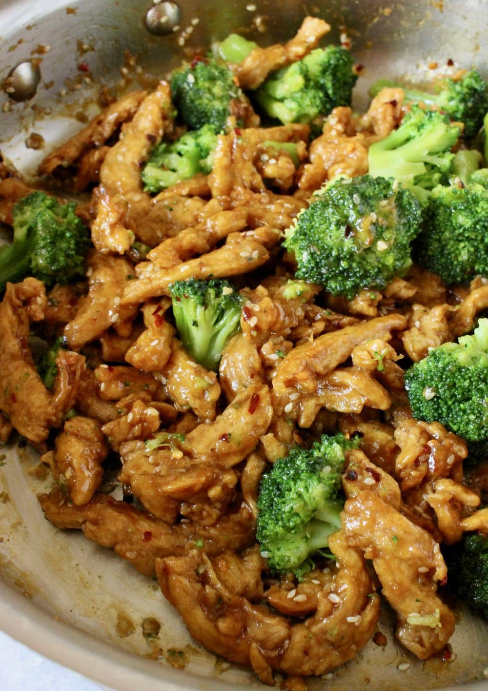 Pan of soy curls with broccoli in garlic ginger sauce