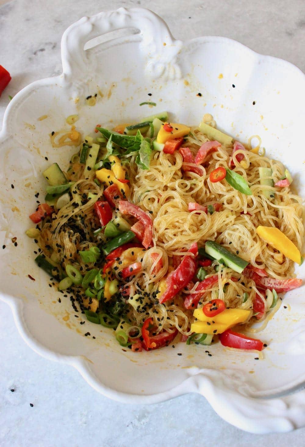 Kelp noodle salad recipe with spicy peanut sauce, tropical fresh mango and crunchy veggies.