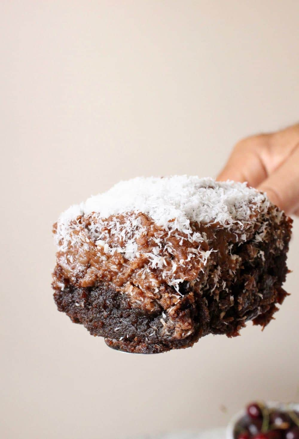 slice of chocolate sheet cake with frosting and coconut