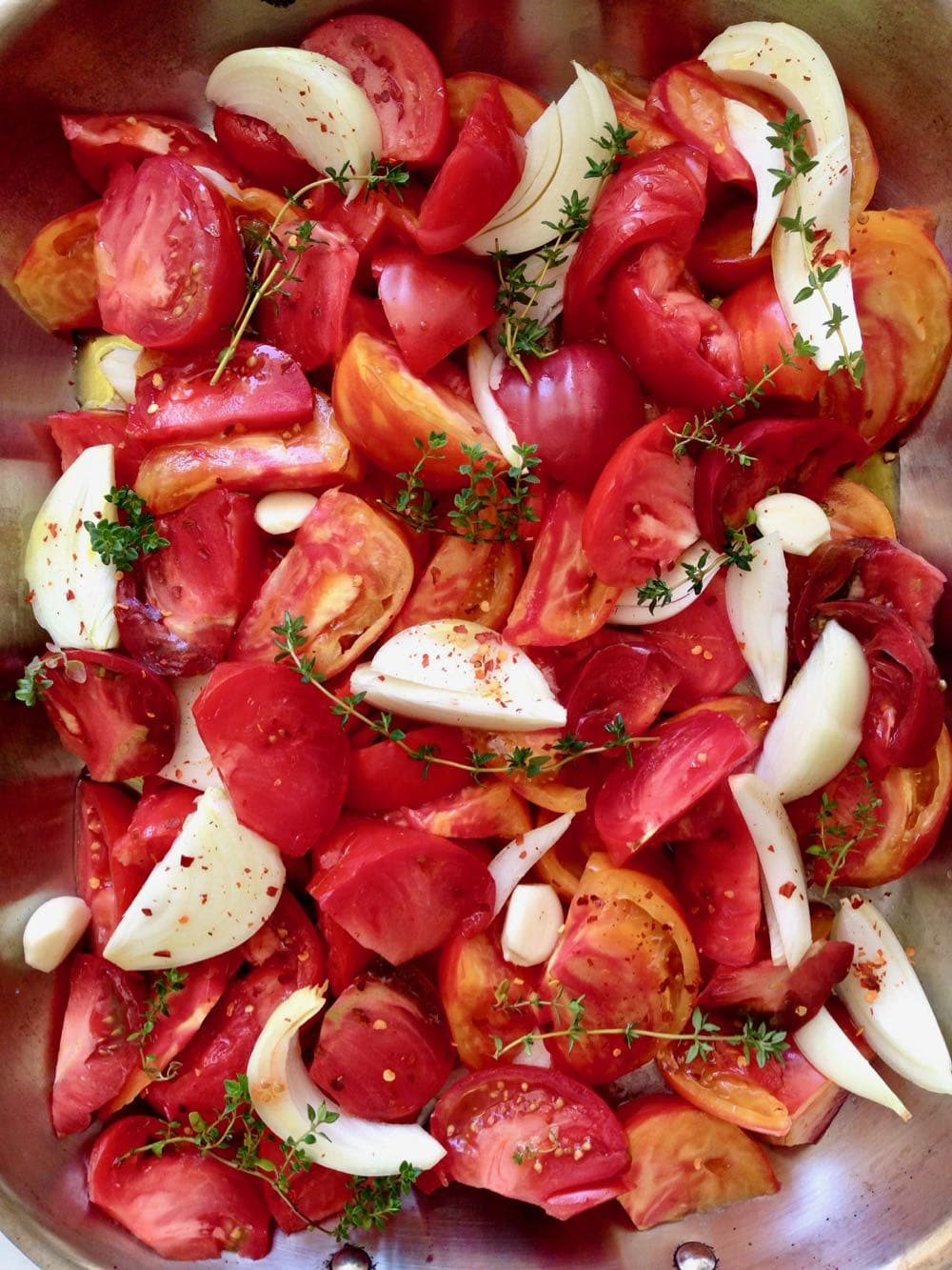 Heirloom Tomatoes, garlic, Onion and Fresh Herbs for Roasting