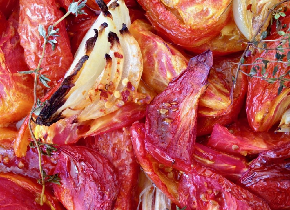 Roasted tomatoes with aromatics for soup.