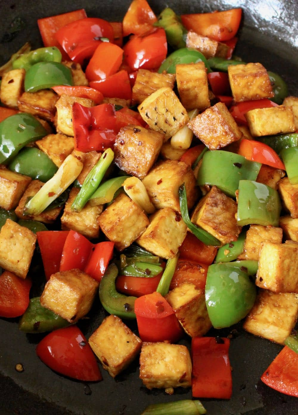 vegan kung pao tofu with bell peppers and scallions